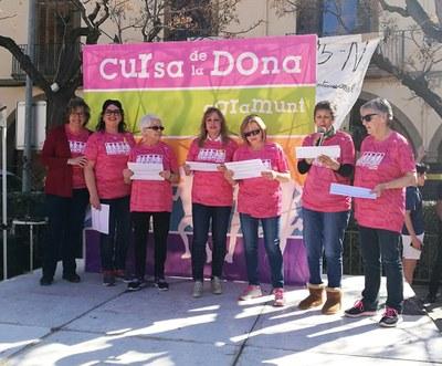 Lectura de frases sobre el paper de les dones a càrrec de l'Associació Dones Esbarjo